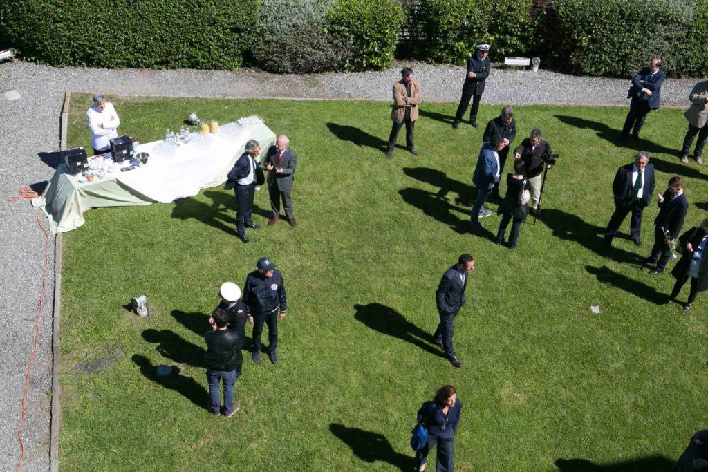 Lanterna di Genova vista panoramica del giardino allestito per evento aziendale di giorno